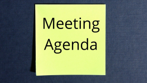 a bright yellow post-it not with Meeting Agenda written on it in black lettering